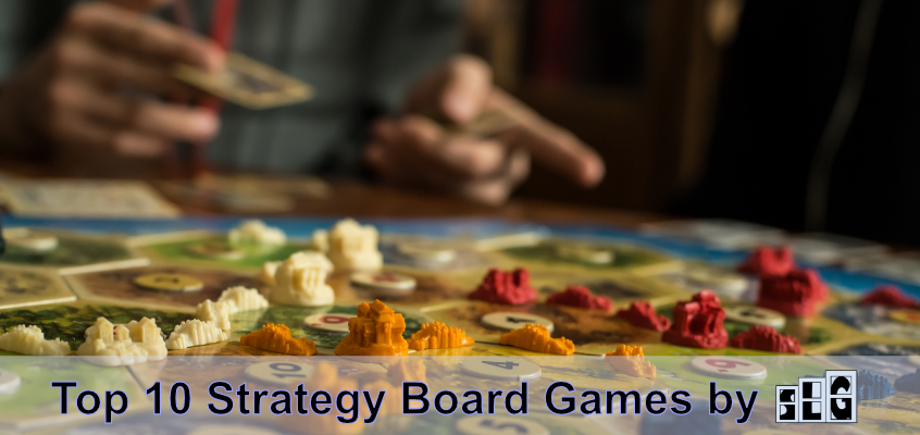 "A board game player pointing at a Settlers of Catan board game that is set up and being played. Text that says ""top 10 Strategy board games by"" with the Streamlined Gaming logo next to it at the bottom"