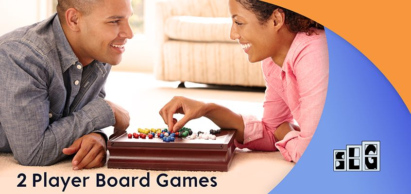 2 people playing a board game together and smiling. Streamlined Gaming image