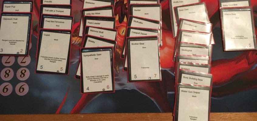 About 40 cards on the table in 6 columns showing off new monster cards for Memaws Monsters Tower Defense Game by Calvin Keeney