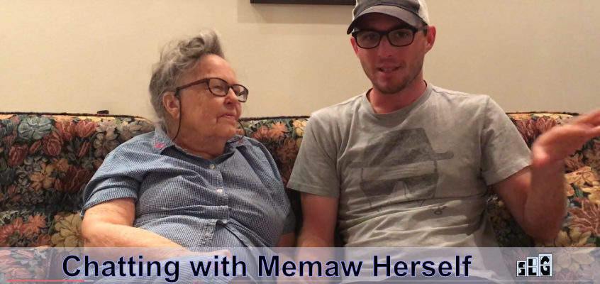 Memaw and her grandson Calvin Keeney holding hands while talking on a couch