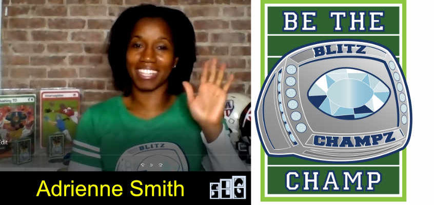 Adrienne Smith waving to the camera with the Blitz Champz card back to the right of her